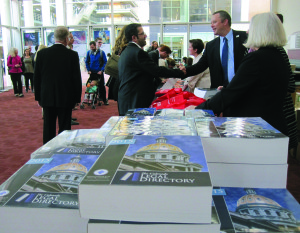 CBA President Loren Brown shaking hands with new lawyers.