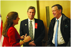 The Hon. Beth Faragher, Charley Garcia and Governor Hickenlooper.