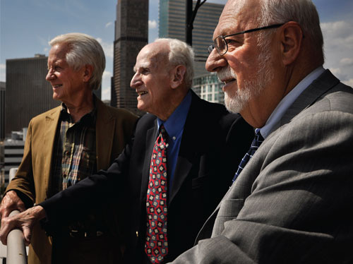 John Conover, left, and Howard Rosenberg, center were founding volunteers of the Thursday Night Bar. Jon Nicholls was also a TNB volunteer. Rosenberg and Nicholls served as executive director of the Legal Aid Society of Metropolitan Denver. Photo by Jamie Cotten.