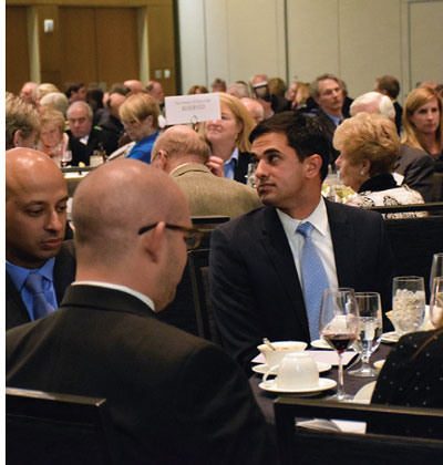 Outstanding Young Lawyer Arash Jahanian dines among colleagues.