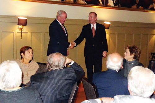 DBA Immediate Past President John Vaught shakes hands with DBA Past President Dan McCune.