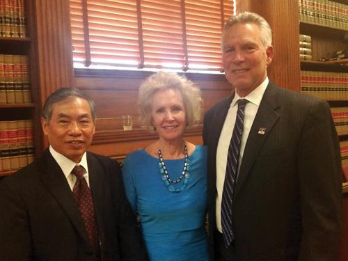 Judge Hada, his wife Linda and Denver County Court Presiding Judge John Marcucci.